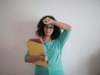 tired adult woman with papers in light modern office 3808818 buchhaltung scaled 1